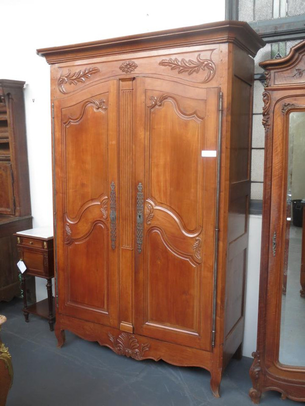 A 2 door French provincial 18th Century light walnut armoire