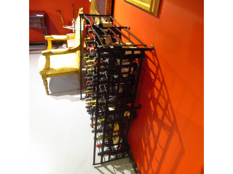 A large French metal free standing wine rack