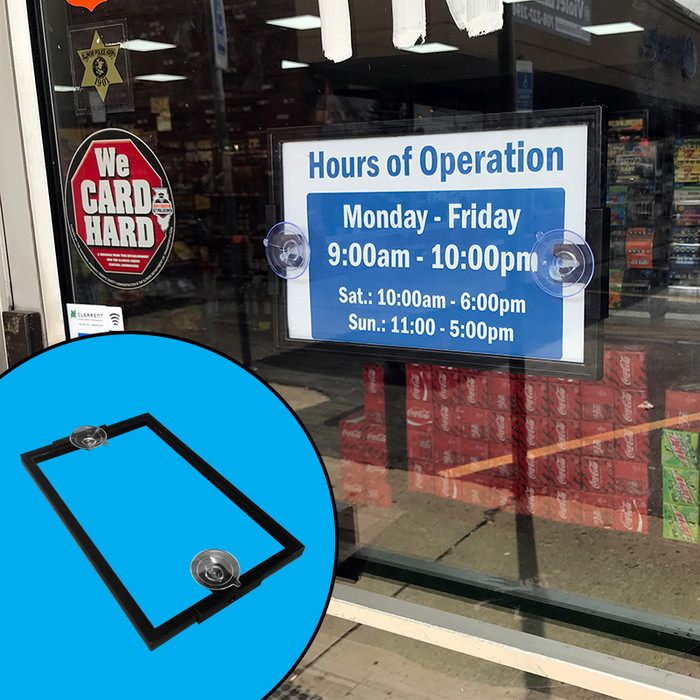 Suction cup sign holder attached to glass door showing business hours, with inset showing double-sided nature of holder.