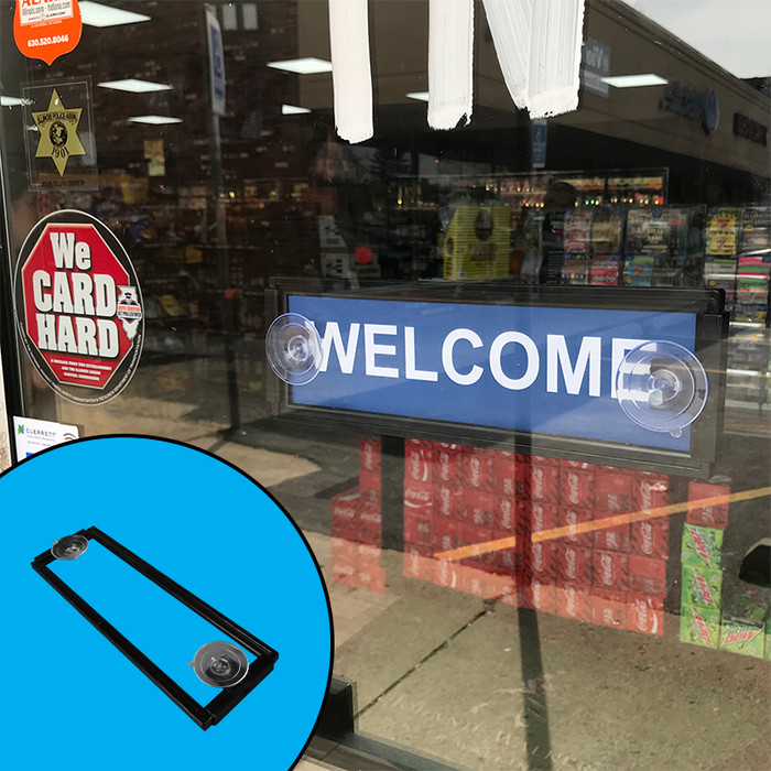 Suction cup sign holder attached to glass door showing a welcome sign, with inset showing double-sided nature of holder.