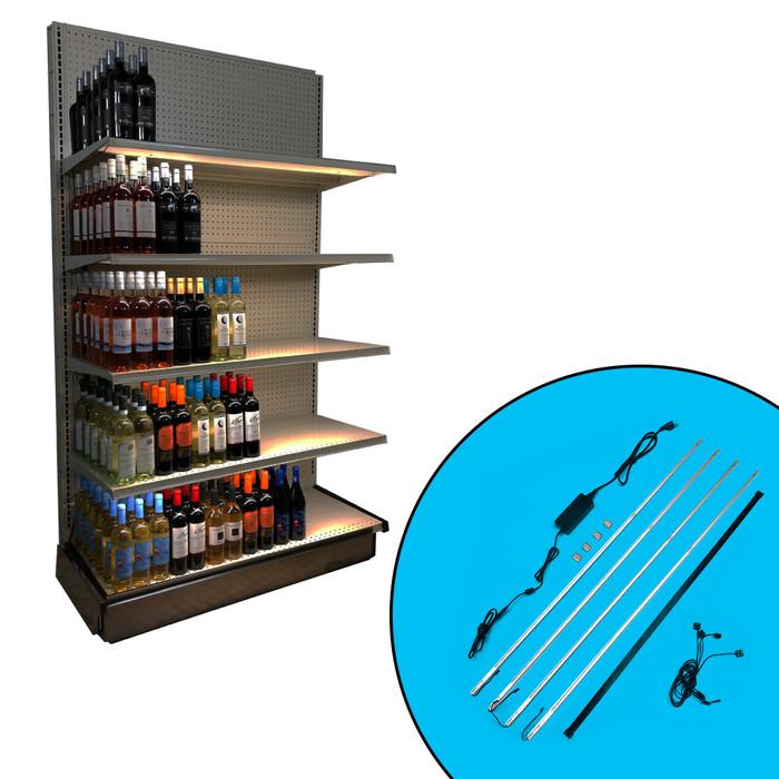 Inline gondola shelving unit show with 4 undershelf lights lighting up partially stocked wine bottle selection.