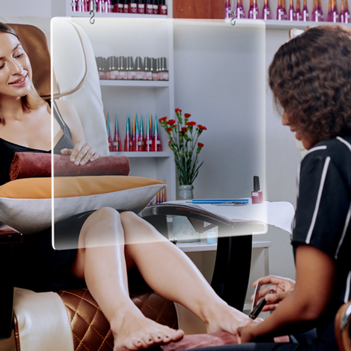 hanging plastic pedicure sneeze guard for nail salons beauty spas over a chair with client customer
