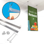 Poster hanger kit, shown with products, attaching poster to product, and completed look.