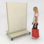 Person looking at a mobile gondola with pegboard, casters and base shelves.