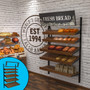 """Retail wall display shown in bakery/cafe configuration with wood slatted shelves, baguettes, bread, and breadsticks. Sign showing """"Fresh Bread"""" included, with secondary view showing telebracket."""