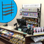 Behind-the-counter retail wall display selling cigarettes and related accessories.