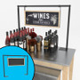 Hanging chalkboard sign shown placed on a nesting table, above various wine bottles.