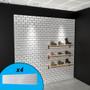 Subway tile textured slatwall wall display with shoes on display.