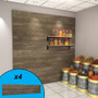 Weathered wood slatwall wall display with spices on display.