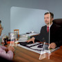 portable plastic desktop sneeze guard on reception counter