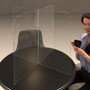 clear plastic table divider sneeze guard designed for use at offices, restaurants or schools.