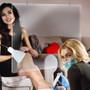 hanging acrylic sneeze guard above pedicure chair at nail beauty salon spa parlor