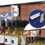 magnetic sign holder with gripper for signs up to 1/4 inch thick that's used to display retail for sale signs and advertisements at stores shown with wine talker signs at a c-store