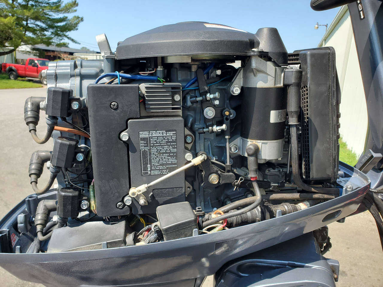 """2009 Yamaha 70 HP 3-Cyl Carbureted 2-Stroke 20"""" (L) Tiller Outboard Motor"""