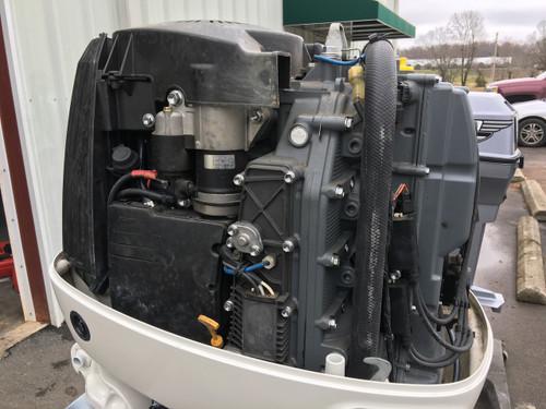 "2003 Johnson/Suzuki 140 HP 4 Cylinder 4-Stroke 20"" Outboard Motor"
