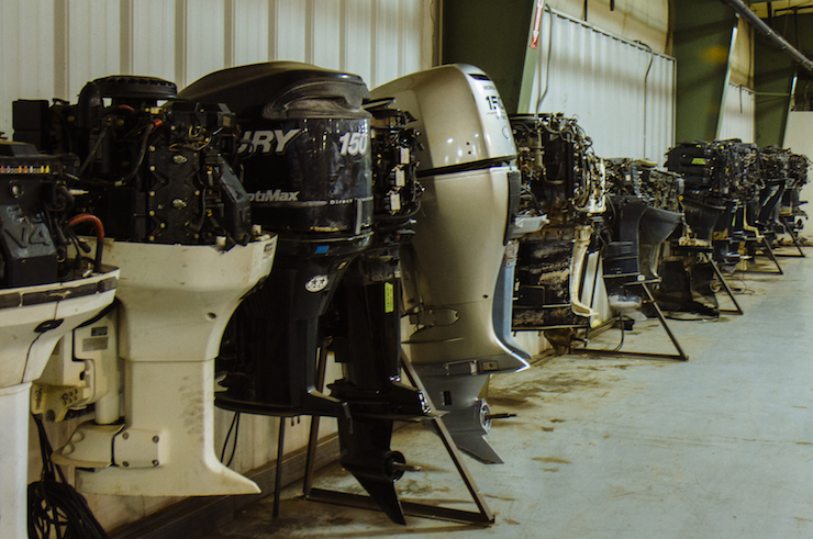 Wall of outboard engines ready to be sold