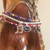 Music Note Charm Bracelet with Red and Purple Corded Bracelets
