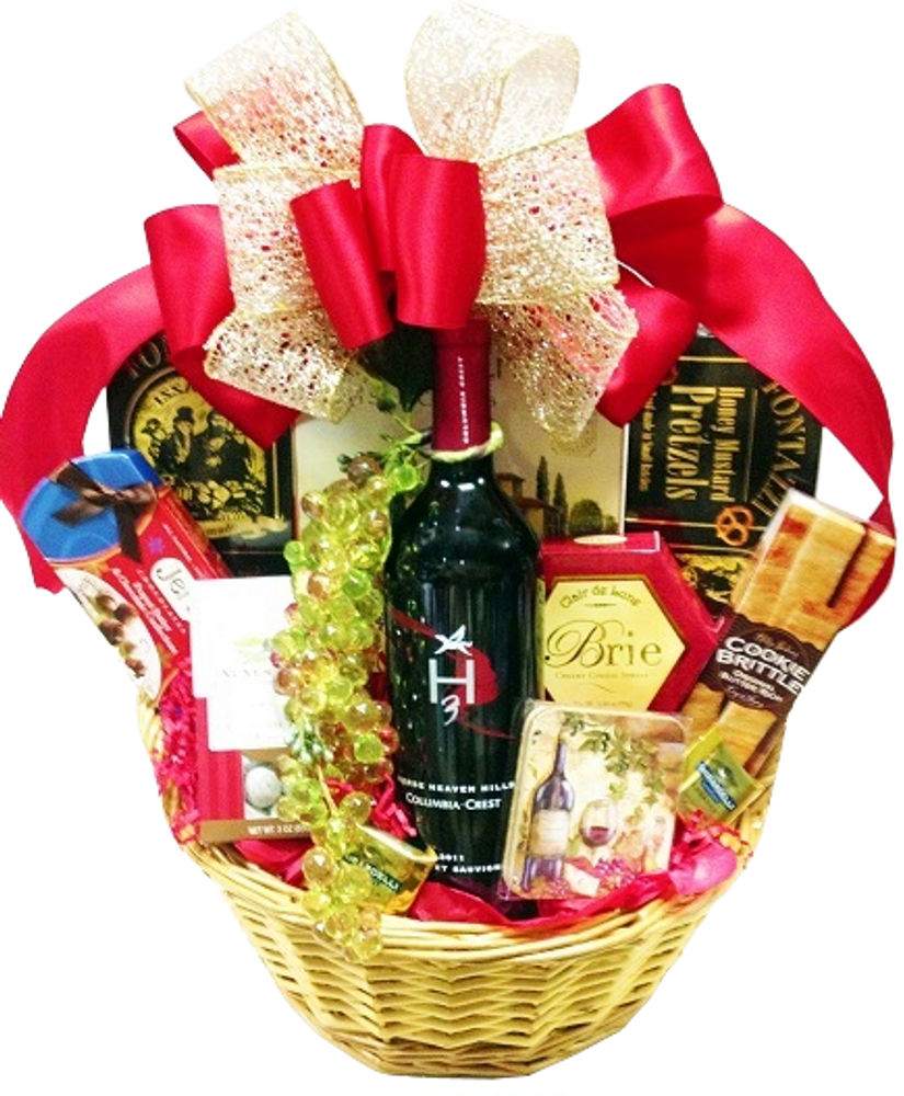 This gift is so elegant it has been used by corporate clients as centerpieces for their event. Includes sparkling cider, wine coasters, chocolates, caramel corn, honey mustard pretzels, brie cheese, gourmet focaccia crackers, toffee brittle cookies, rolled pastry cookies, Ghirardelli chocolates, nuts and a decorative grape enhancement.  (Items of equal or greater value may be substituted, depending on availability, or discovery of great new items.)