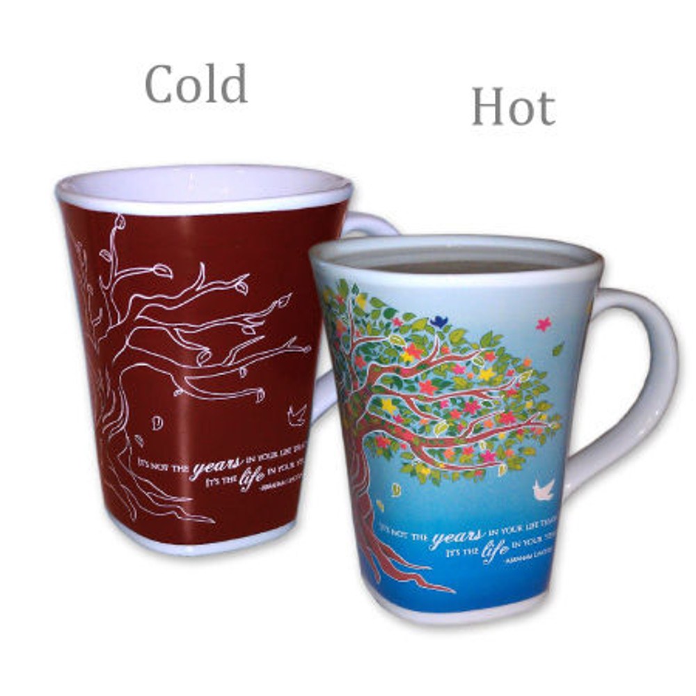 """This beautiful and unique mug changes it's design and colors when Hot coffee, tea, or hot cocoa is added. As the bare tree turns magically in to a beautiful, colorful, blossoming tree, with a blue sky background, the words say, """"It's not the years in your life that count, It's the life in your years!"""" It comes with a matching plaque that says """"Enjoy Every Moment!"""""""