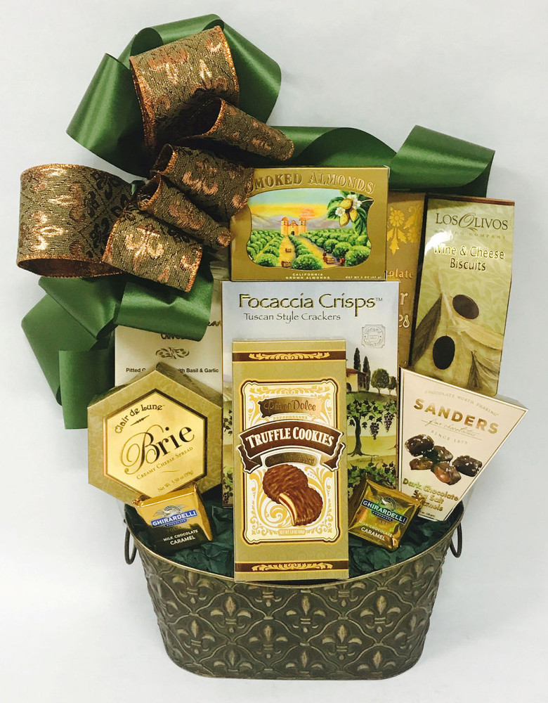 This elegant, embossed Fleur-de-lis tin makes a great decorative home accent or planter after the goodies are devoured. The yummy gourmet assortment includes nuts, brie, crackers, wine and cheese biscuits, olives, chocolate sea salt caramels, chocolate truffle cookies, and Ghirardelli squares.