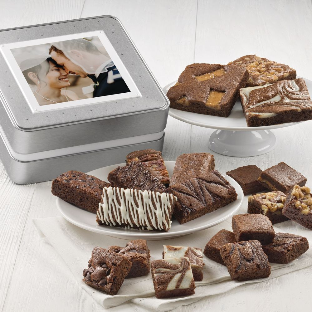 This beautiful custom keepsake photo tin, designed especially for you, is filled with an assortment of  the most delicious, freshly baked, melt in your mouth chocolate brownies! Includes 21 brownies. This is a great gifts to welcome out of town wedding guests, to thank members of the bridal party, or with a special city skyline photo to welcome meeting or convention attendees. Call  for details.
