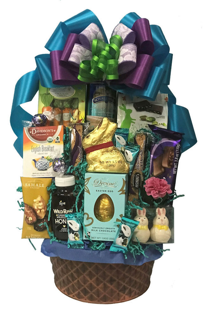 Grownups want Easter Baskets too!! This one can be enjoyed by the whole family. It makes a great centerpiece on the Easter buffet table, and is filled with delicious chocolates, cookies, nuts, tea and honey, mini bunny salt and pepper shakers, and more. It is presented in an elegant bronze tin that can be used as a fruit bowl or planter after the goodies are devoured.
