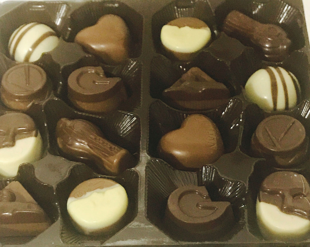 Includes a beautiful gift box of fine Belgian chocolate truffles!