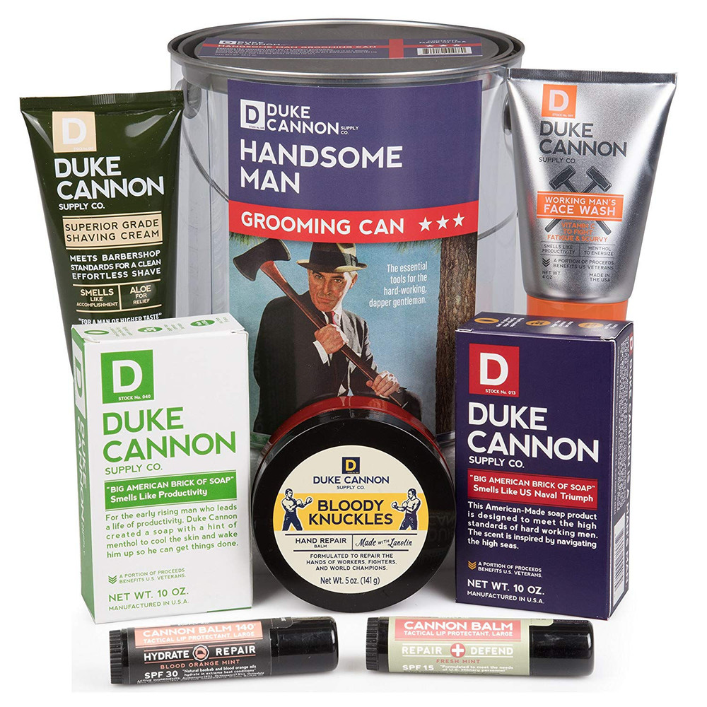 Premium male grooming essentials gift set in a see-through paint can from Duke Cannon Supply Company. Contains 7 high quality masculine and refreshing grooming products:  WORKING MAN'S FACE WASH with refreshing citrus scent, some grit for optimal cleansing, energizing menthol, jojoba and vitamin c. BLOODY KNUCKLES HAND REPAIR BALM A hearty serving that will last a long time. Made with lanolin, provides moisture without leaving the hands feeling sticky or greasy! CANNON BALM TACTICAL LIP Protectants -(Two)  One fresh mint taste and one blood orange. All premium, natural and organic ingredients with sun protectant and 4 times the size of the ones seen in stores. BIG ASS BRICKS OF SOAPS - Two bars, each three times the size of the average bar of soap. A steel cut texture for extra grip. SUPERIOR SHAVING CREAM and a cool container to keep it all handy in. We will add some high end coffee and power bars, so he can start his day feeling fresh and energized! This is a great gift for Father's Day, graduation, birthday, Groom gift, or for any occasion.  Note: Deluxe version available with Coffee, Chocolates, Cookies and Snacks stacked on top. Call to upgrade.    Premium male grooming essentials gift set in a see-through paint can from Duke Cannon Supply Company. Contains 7 high quality masculine and refreshing grooming products:  WORKING MAN'S FACE WASH with refreshing citrus scent, some grit for optimal cleansing, energizing menthol, jojoba and vitamin c. BLOODY KNUCKLES HAND REPAIR BALM A hearty serving that will last a long time. Made with lanolin, provides moisture without leaving the hands feeling sticky or greasy! CANNON BALM TACTICAL LIP Protectants -(Two)  One fresh mint taste and one blood orange. All premium, natural and organic ingredients with sun protectant and 4 times the size of the ones seen in stores. BIG ASS BRICKS OF SOAPS - Two bars, each three times the size of the average bar of soap. A steel cut texture for extra grip. SUPERIOR SHAVING CREAM and a cool