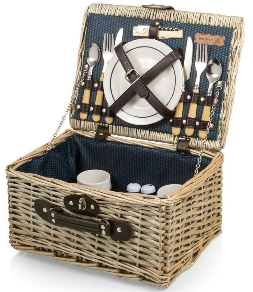 style picnic basket. It includes two each - ceramic plates, ceramic mugs, and silverware, along with a salt and pepper shaker, and stainless steel, waiter style corkscrew.  If you would like to upgrade the basket to include an assortment of sweet and savory gourmet items, just give us a call.