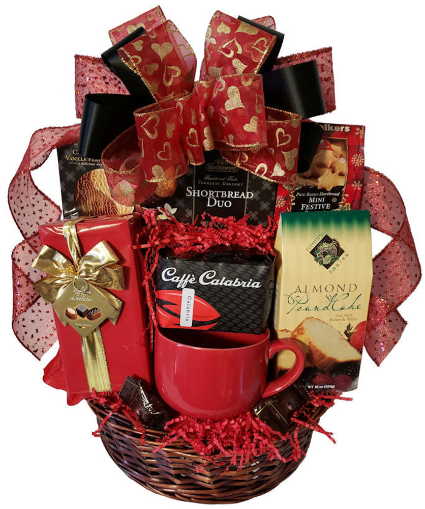 This striking basket is brimming with decadent desserts and one of the best coffees on the planet. Includes Calabria coffee, Almond Pound Cake mix (great topped with strawberries!) Belgian chocolates, shortbread, chocolate chip cookies, Godiva Chocolates, and biscotti.   It is perfect for Valentine's Day,  Mother's Day, Anniversary or Birthday. A personalized ribbon banner can be added upon request.