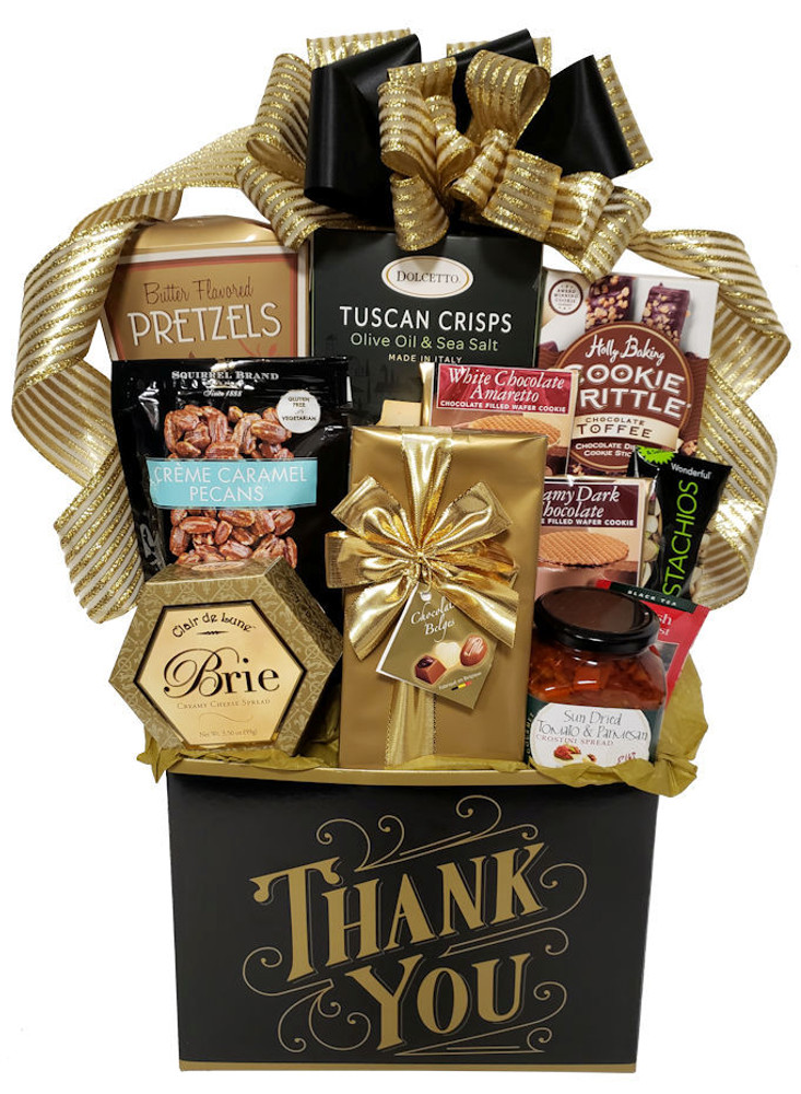 When you want to express gratitude with a touch of class! This striking black and gold Thank You Box is not only elegant, but includes an upscale assortment that is scrumptious and great for sharing. Includes:  Cheese Tuscan Crisps imported from Italy Caramel Pecans Chocolate Toffee Brittle Cookies Gourmet Pretzels Scrumptious Sun Dried Tomato & Parmesan dip with Capers Fine Belgian Chocolates  Wafer Cookies  Items of equal or greater value may be substituted depending on availability and the discovery of great new seasonal items.