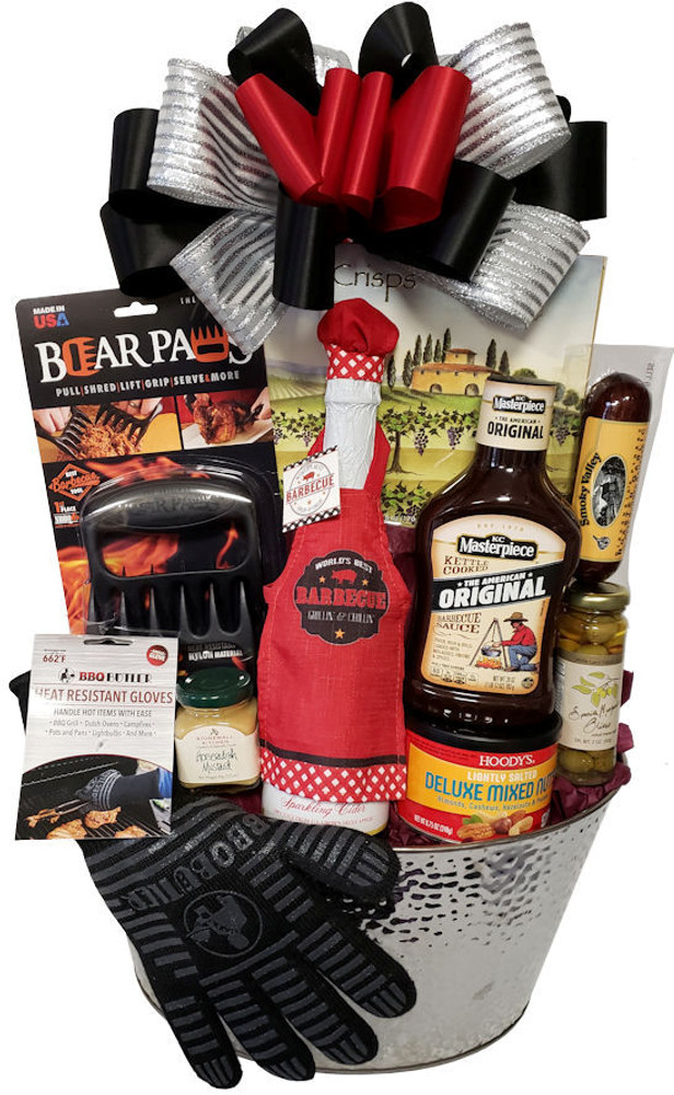 A large silver party bucket filled with appetizers and BBQ tools that would thrill anyone who loves to cook or barbecue. The gift includes:  A heat resistant glove Sparkling cider wearing a BBQ apron and chef hat Gourmet BBQ sauce Deluxe mixed nuts Olives Sausage Mustard Bear Paws (voted best barbecue tool) Hammered silver party bucket Great for Father's Day, birthdays, housewarming gift, thank you and raffle prizes  Items of equal or greater value may be substituted depending on availability and the discovery of great new seasonal items.
