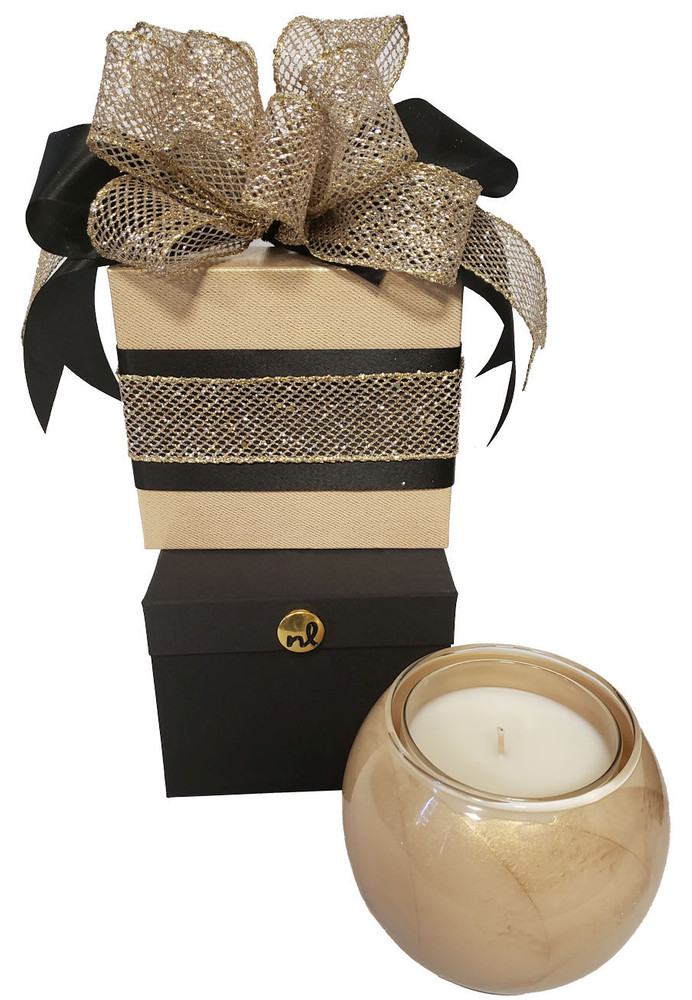 """A winning combination of a gorgeous candle globe for the home and a box of high end chocolate truffles. The candle globe is filled with a patented Mysteria fragrance, and the refillable candle globe is painted with swirls of shimmering gold. The candle burns for 50 hours and fills the room with the beautiful fragrance.  The candle globe comes in a satin box (black satin on the outside and ivory satin on the inside.) The box can be used for jewelry, pictures or keepsakes.  The gold gift box on top contains five large, scrumptious chocolate truffles.  This is a great gift for housewarming, thank you, employee recognition (Banner Can Say """"You Light Up The Office""""!) and can be decorated for any occasion.  Note:  This gift ships same day or next business day if ordered by 1:00 pm.  Cookies will be substituted for chocolate during warm weather."""