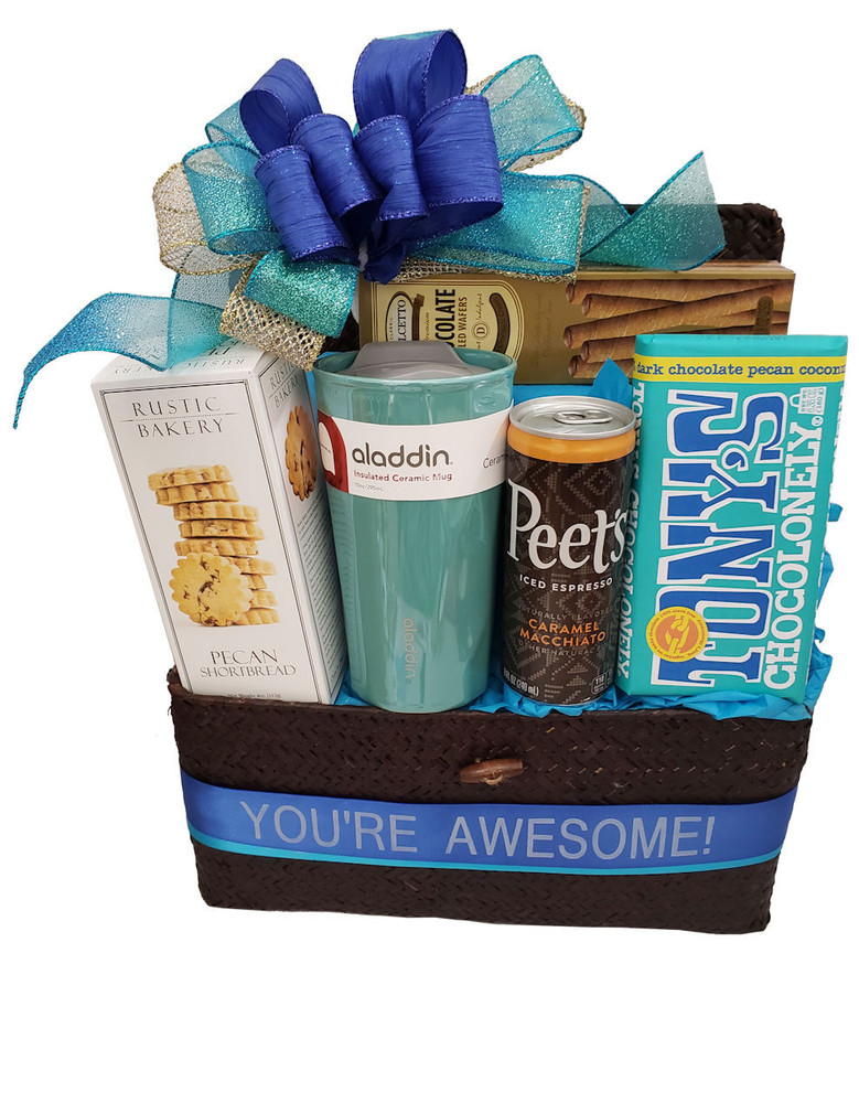 """This charming Sea Grass chest will be enjoyed long after the goodies are gone. Includes:  A Ceramic Travel Mug Delicious Shortbread Cookies Peets iced Caramel Machiato Chocolate Filled Pastry Cookies A large, scrumptious, Chocolate, Coconut, Pecan Bar """"you're Awesome!"""" Banner (Can be personalized) Items of equal or greater value may be substituted depending on availability and the discovery of great new products."""