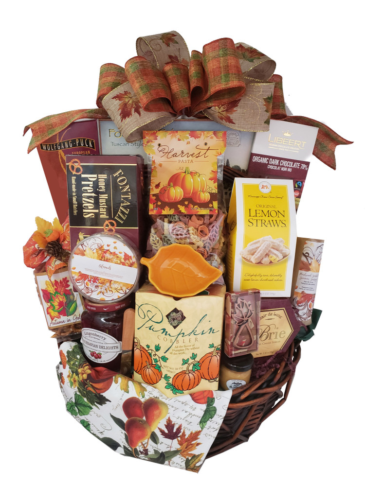 This gorgeous basket, with several keepsakes and all the beautiful colors and flavors of Fall, will create a lasting memory! Includes: European Style Coffee Honey Mustard Pretzels Harvest Pasta Focaccia Crackers Organic Dark Chocolate Lemon Cookies Sausage and mustard Cheese Fall Leaf Bottle Opener Linen Napkin Fall Dip Dish Almonds Autumn Snack Mix Lingonberry Jam Chocolate filled wafer cookies Tea Pumpkin Cobbler Mix