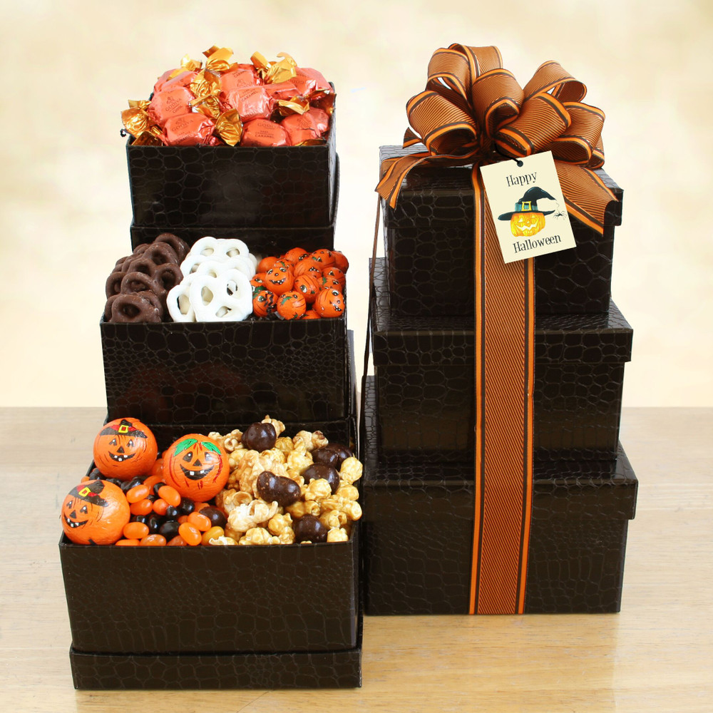 Black stacking boxes filled with chocolate truffles, dark chocolate pretzels, white chocolate pretzels, chocolate caramel corn, jelly beans and assorted candy.