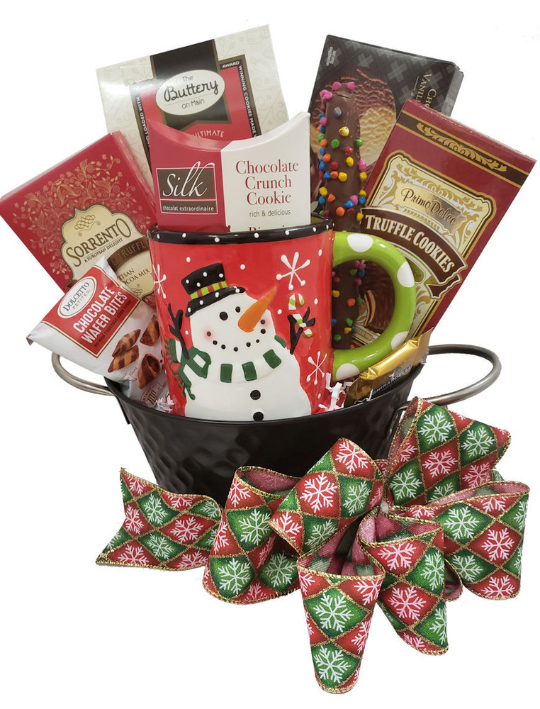 This is so adorable with the silver handled tin container and the over sized snowman mug, it always delivers big smiles! It is filled with hot cocoa, shortbread, chocolate truffle cookies, chocolate chip cookies, wafers, and a chocolate dipped pretzel rod.