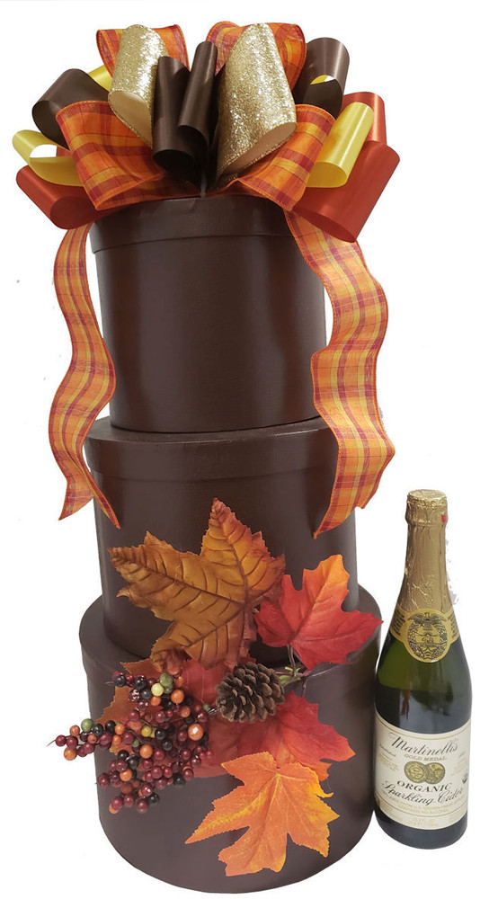 This is a beautiful presentation and can be decorated for any holiday, theme or occasion. It comes with a bottle of Martinelli's Sparkling Cider, and upscale gourmet items including cheeses, crackers, gourmet spreads, snacks, assorted nuts, assorted cookies, shortbread, coffee, tea, fine Belgian chocolates,biscotti, confections, and much more.  If you would like to upgrade to wine or champagne instead of sparkling cider please give us a call.