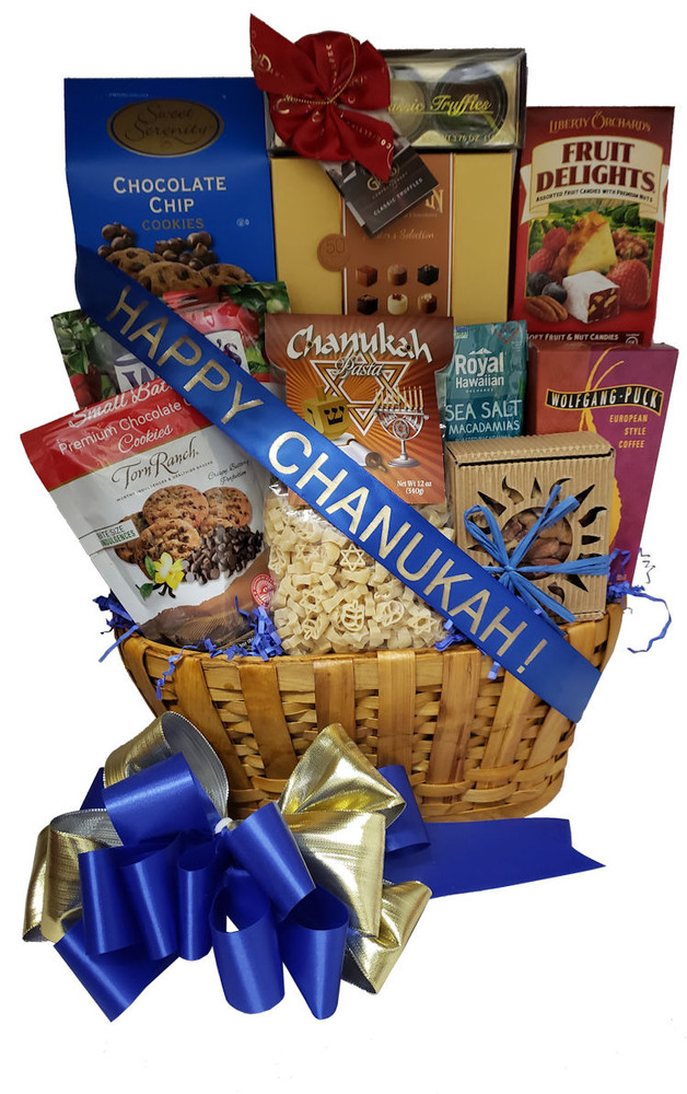 This elegant Chanukah basket is presented in a nice wood, drop handle, basket and filled with a delicious assortment of kosher goodies. It is great for the whole family to share. Includes:   Fine Belgian Chocolates Chocolate Chip Cookies made in small batches Fruit Delights - Fruit and Nut Candies Sea Salt Macadamia Nuts European Style Coffee Chanukah Pasta (shaped like stars and dreidels) Dried Honey Crisp Apples Giant Chocolate Truffles Fancy Mixed Nuts Items of equal or greater value may be substituted depending on availability .
