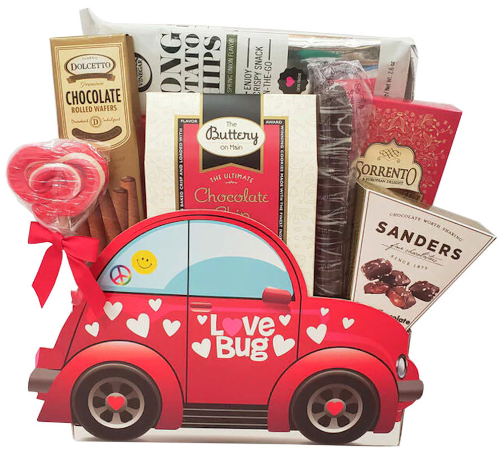 This adorable Love Bug Mobile is guaranteed to deliver big smiles! It is filled with delicious chocolates, cookies, imported long chips, cocoa, a strawberry shortcake  lollipop, and snacks.