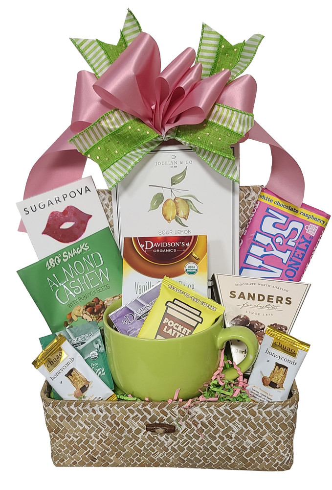 Brimming with delicious assorted teas and desserts, this gift also features a Sea Grass Chest (a nice storage container) and a large soup/mug, perfect for coffee, tea, soup, cereal, ice cream and snacks.   Includes:  Pocket Latte chocolate  Snack Mix Chocolate Sea Salt Caramels Chuao Chocolates Ceramic Soup/Mug Lemon Cake Cookies with cream cheese drizzle Delicious assorted chocolate confections Sea Grass Chest Items of equal or greater value may be substituted depending on availability.
