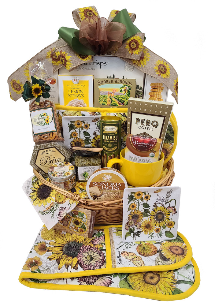A Deluxe basket, filled with cheery and bright sunflower themed gift items to brighten any kitchen, and delicious snacks. The drop handle basket makes a great market basket or to take to the beach or on a picnic.  The gift includes:  Sunflower dessert plate Sunflower double oven mitt. Can also be used as a decorative runner in the middle of the Fall dinner table Candle Sonoma Jack Cheese Oversized coffee/soup mug Brie Rolled and chocolate filled pastry cookies Gourmet Coffee Meyer Lemon Shortbread Artichoke Lemon Tapenade Mini Bamboo Spoon Snack Mix Tea Apricot Cookies