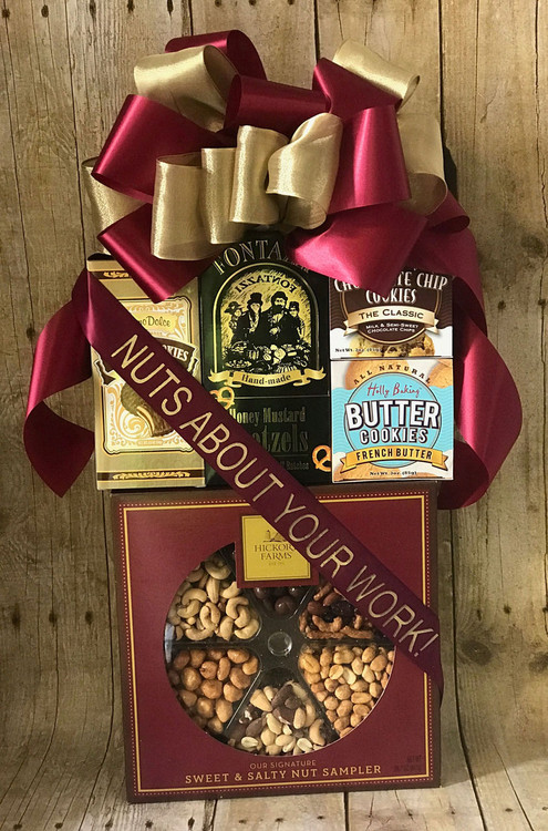 This gift is filled with delicious snacks and perfect for sharing with friends or family! Includes a large gift box of assorted sweet and salty nuts (chocolate peanuts, cranberry & sesame nut mix, honey roasted peanuts, roasted salted whole cashews, butter toffee peanuts, almonds, Brazil nuts, pecans, cashews in a traditional nut mix). The gift also includes savory honey mustard pretzels, classic chocolate chip cookies, butter cookies, truffle cookies, and rolled, chocolate filled pastry cookies.  The free ribbon banner can be personalized for any occasion. Great for Administrative Professionals' Day, Thank You, Birthday, and Hostess Gift!