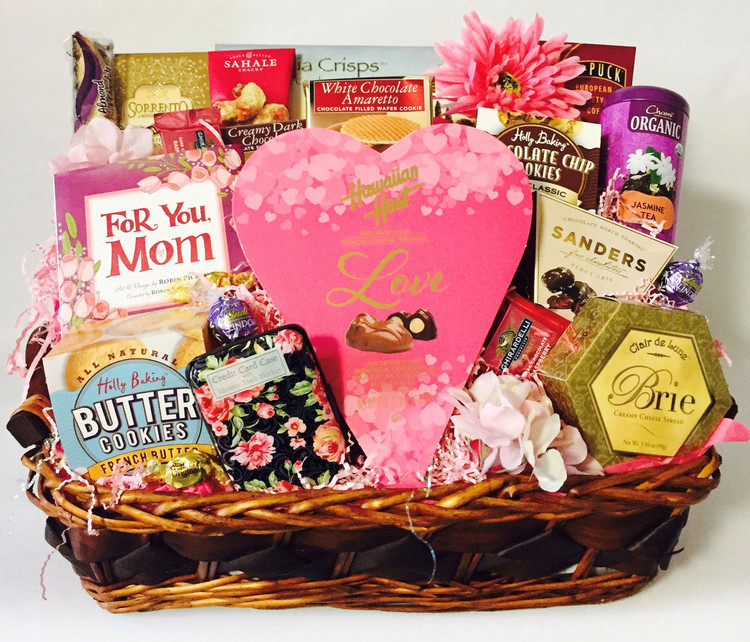 Mom will feel so special when this elegant tray, filled with gift items, gourmet goodies and confections, arrives on her special day! The  tray includes a book for mom,  designer floral credit card holder (can also be used for business cards) chocolate macadamia nuts in a heart shaped box, French butter cookies, chocolate chip cookies, a tin of tea, coffee,  nut mix biscotti, Relaxation Mind And Body soak, and floral enhancements. If you would like to customize it, give us a call! Free ribbon banner can be added with any message of your choice. Great for Mother's Day, Birthday, and just because!