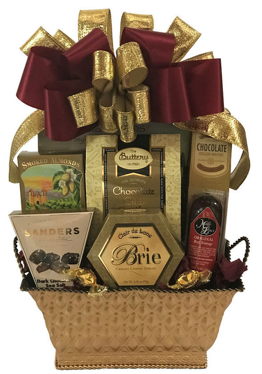 A beautiful gold tin filled with delectable gourmet delights. Includes chocolate sea salt caramels, smoked almonds, chocolate chip cookies, cheese, crackers, sausage, and wafer cookies. The gift is topped off with an elegant hand made bow. Perfect for any holiday or occasion!  Items of equal or greater value may be added depending on availability.