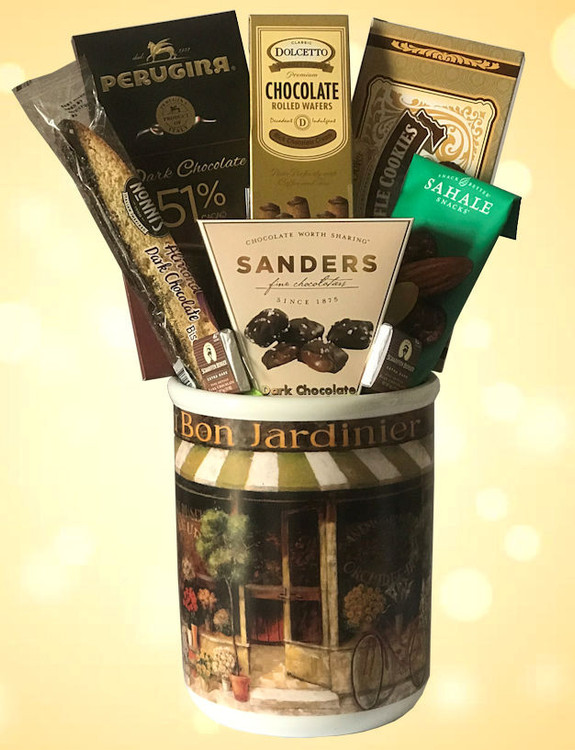 An elegant, French themed ceramic container with beautiful image of a European flower shop, filled with nuts, cookies and chocolates. The container makes a great wine chiller, planter or on the buffet table filled with fruit salad, or snacks.