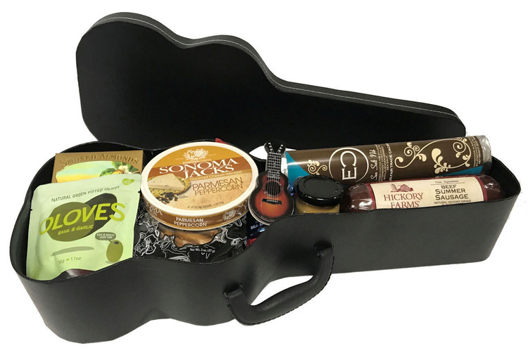 A unique and fun design for any music lover! Includes cheese, crackers, olives, pretzels, sausage, mustard and a high end gourmet chocolate bar from Eclipse Chocolate, all in a guitar case shaped basket! Makes a great gift for Father's Day!   Items of equal or greater value may be substituted depending on availability!