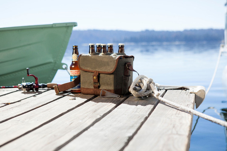 Any beer lover will be thrilled with this soft-sided beer cooler to fill with their favorite cold beverages. The waxed cotton canvas exterior looks way cooler than a cardboard box, and it comes with a retractable bottle opener built-in so you never have to worry about it walking off - It also comes with a removable padded divider and an adjustable shoulder strap. It holds six bottles securely, while allowing you to remove each bottle without having to open the flap. Keep your beverages cold and classy with the most unique beer cooler ever! Great gift for Father's Day, Birthdays, Fourth Of July, boating, beach, picnics and more!
