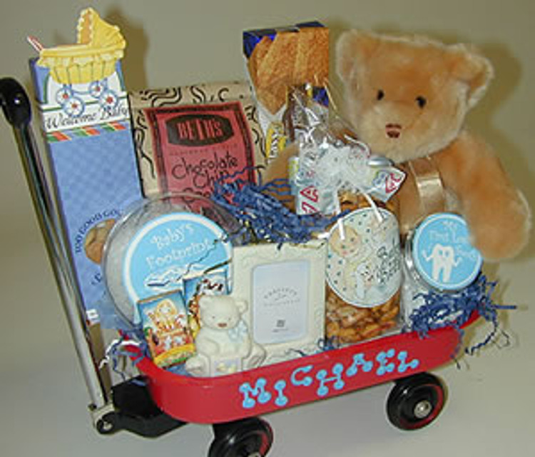 A top of the line Radio Flyer wagon that will look cute in the nursery, to store baby toys, blankets, etc.,  and will become a favorite toy when the baby becomes a toddler. Includes an assortment of baby gift items,  plush bear, and some goodies for mom and dad to share.