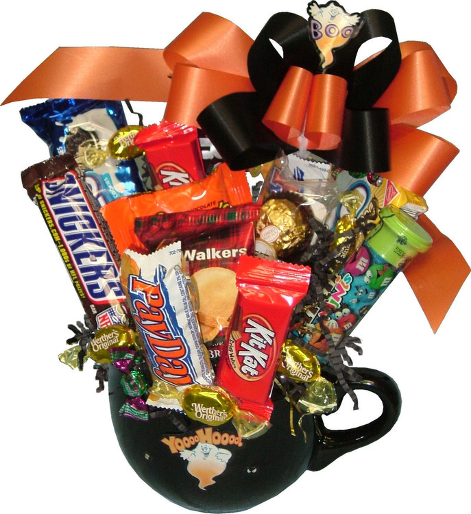 A large mug, perfect for a hot drink, soup, snacks, etc. filled with assorted cookies and candy bars.
